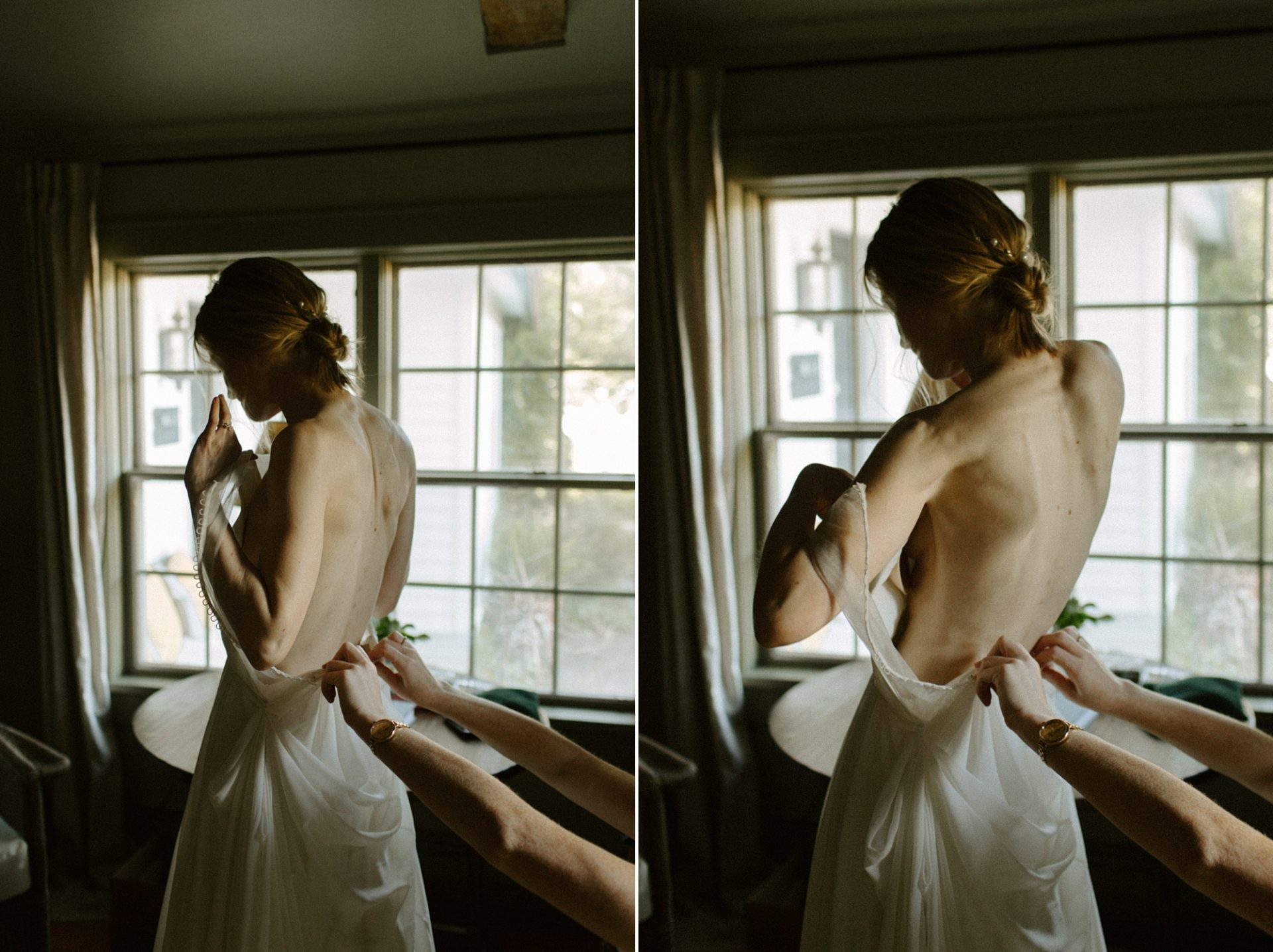 Bride putting her dress on at M & D Farm
