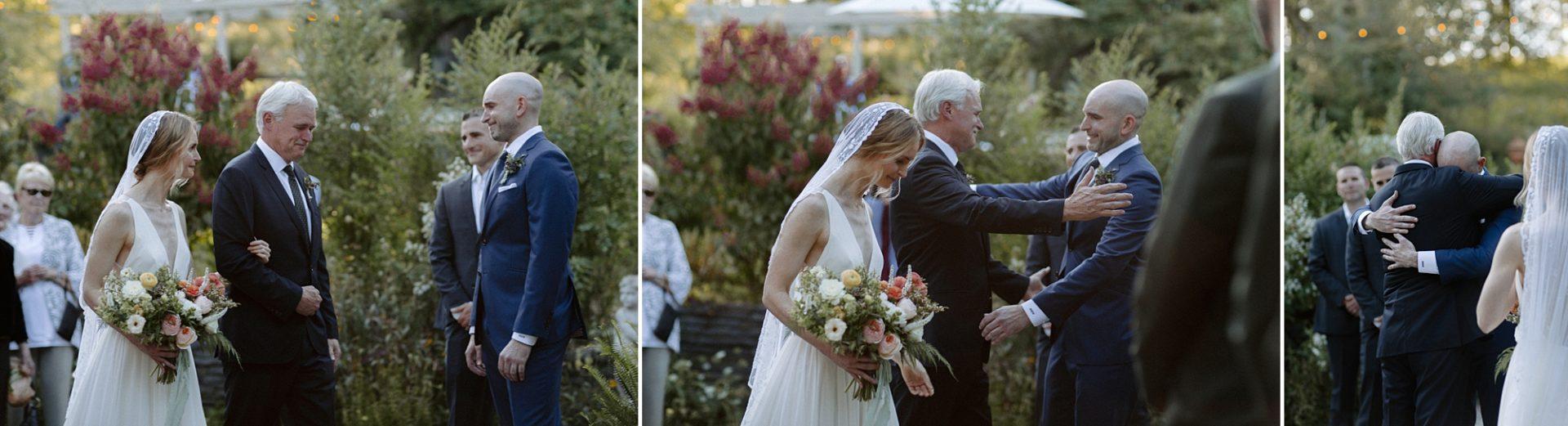 Bride's dad hugging the groom at M & D Farm